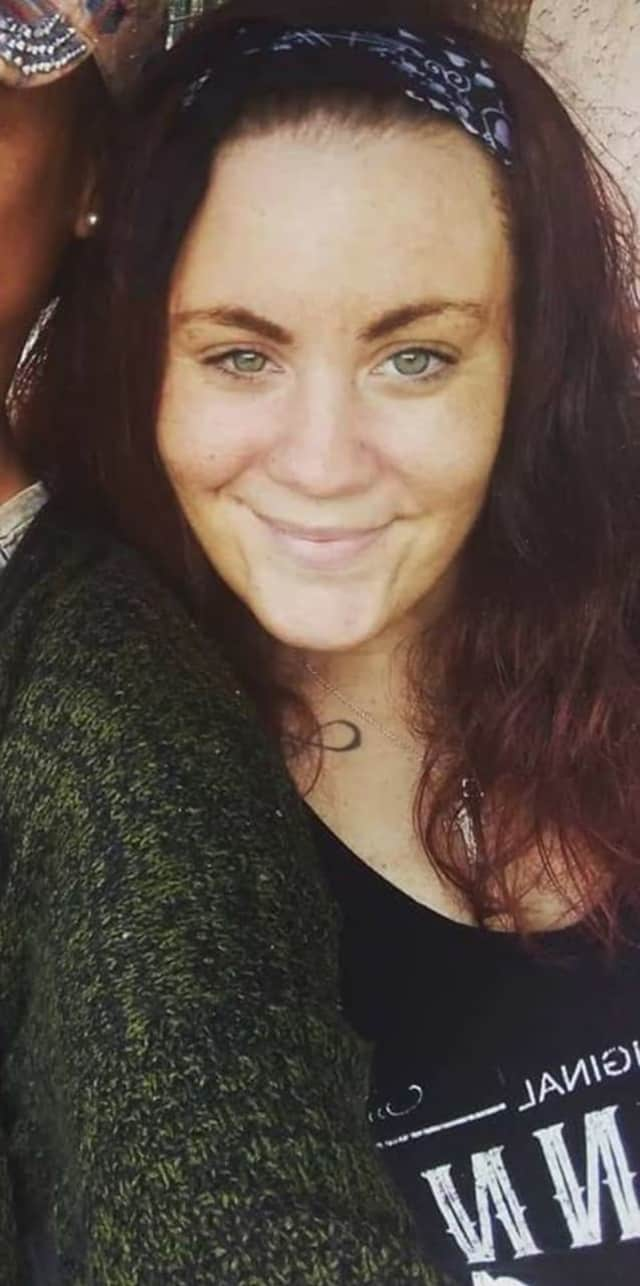 Erin Stack, 35 of Ridgefield Park, was wearing a black Johnny Cash T-shirt, a gray sweater, black and white leggings, black Converse sneakers and a blue bandana headband.