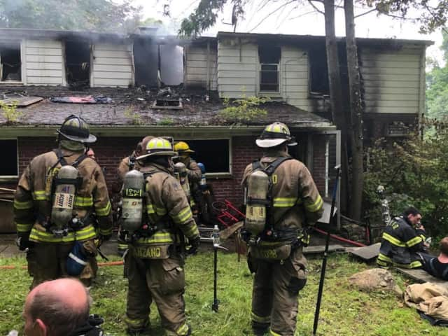 A two-story home in Kent was destroyed by fire.