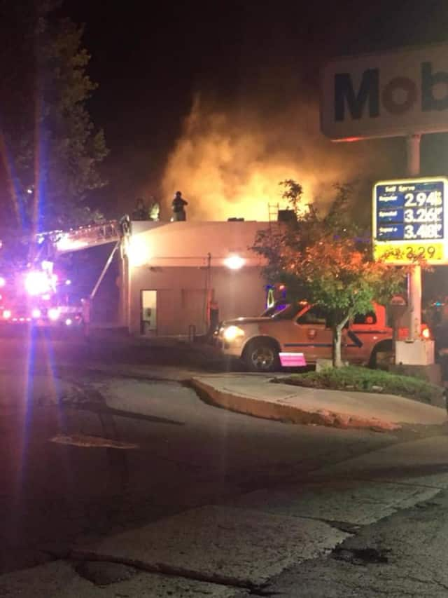 A Mobil station was destroyed by a fast-moving fire.