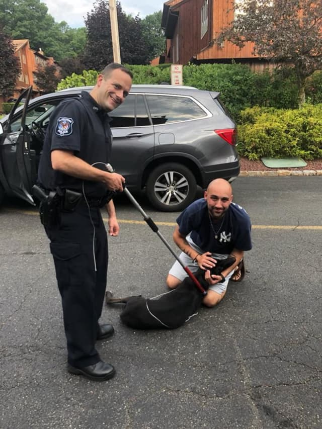 Bones and his owner Nick in New City, reunited with the help of the Clarkstown Police Department.