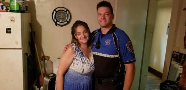 Officer Jim Schoenleber and the woman whose life he helped save.