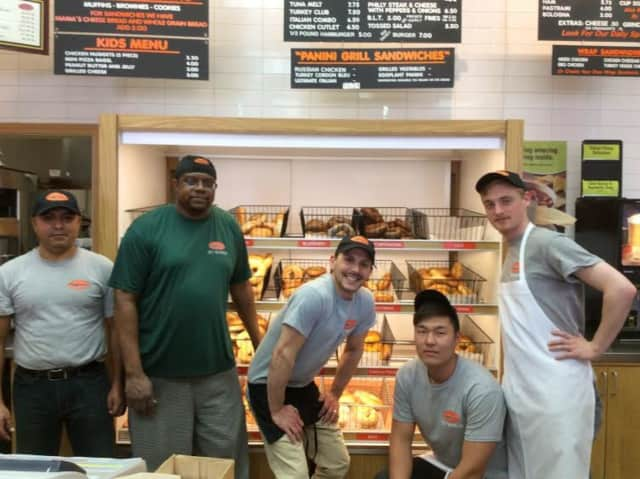 The crew at Bagelman takes a break from baking to show off the wide selection of bagels at the Brookfield and Danbury locations.