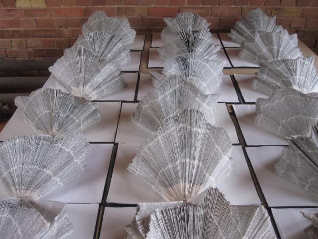Dictionaries repurposed into art. Photo credit by With Associates, via Flickr, subject to Creative Commons license: https://creativecommons.org/licenses/by-sa/2.0/