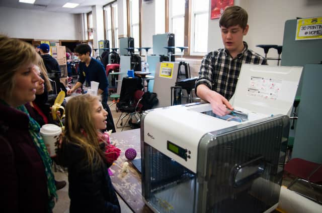 Ridgewood families learn about the 3-D printer at Super Science Saturday.