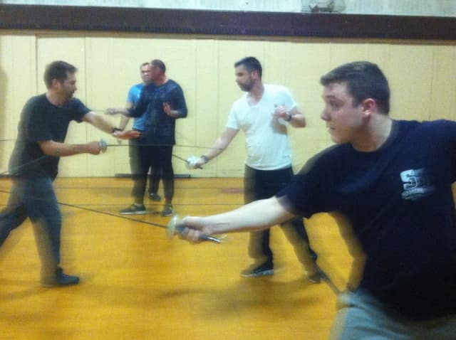 "Cast members BJ Kisch, Tim Stalker and Louis Yorey square off at ""The Three Musketeers"" rehearsal."
