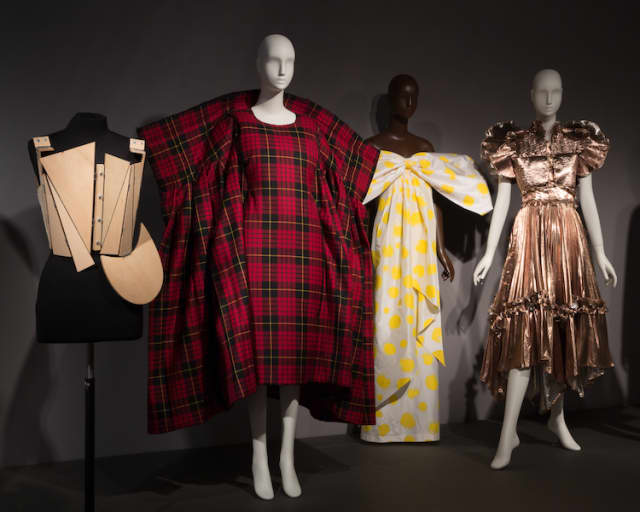 """An introductory platform highlighting minimal and maximal looks in the Fashion and Textile History Gallery of The Museum at FIT, where """"Minimalism/Maximalism"""" continues through Nov. 16. Photograph © The Museum at FIT."""