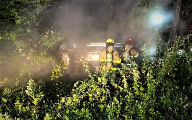 Firefighter Lukas Graf was in his car when he spotted the burning SUV in the woods off Cahill Cross Road around 11:15 p.m. Saturday.