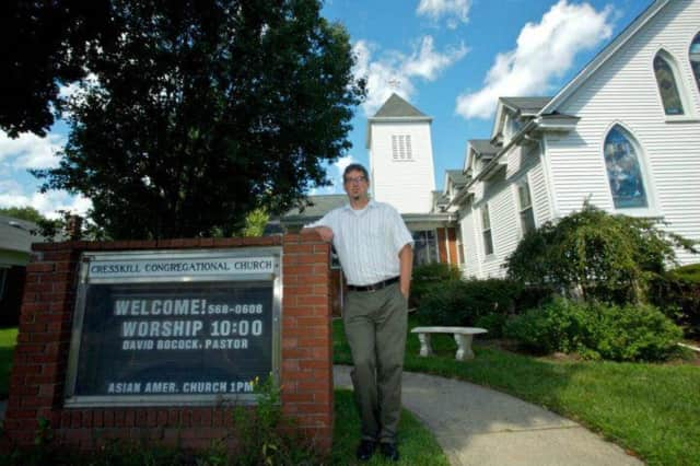 Rev. Dr. David C. Bocock stands outside Cresskill Congregational Church, UCC.
