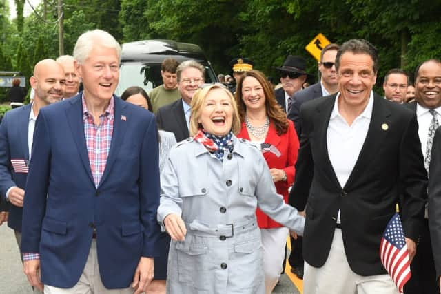 Bill and Hillary Clinton march in the New Castle Memorial Day Parade in 2018 alongside New York Gov. Andrew Cuomo. All three resident in the town, which includes the hamlet of Chappaqua, where the Clintons live.