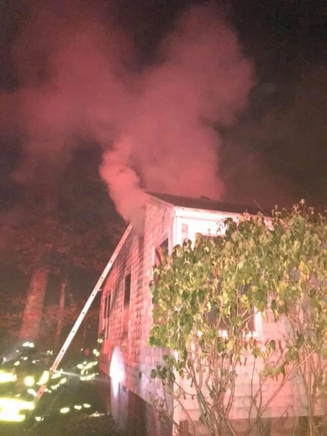 Four family members escaped a fire that started in the ceiling of their Norwalk home.