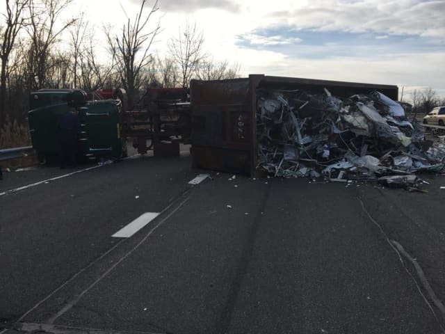 Route 304 is closed northbound after a truck overturned blocking the roadway.