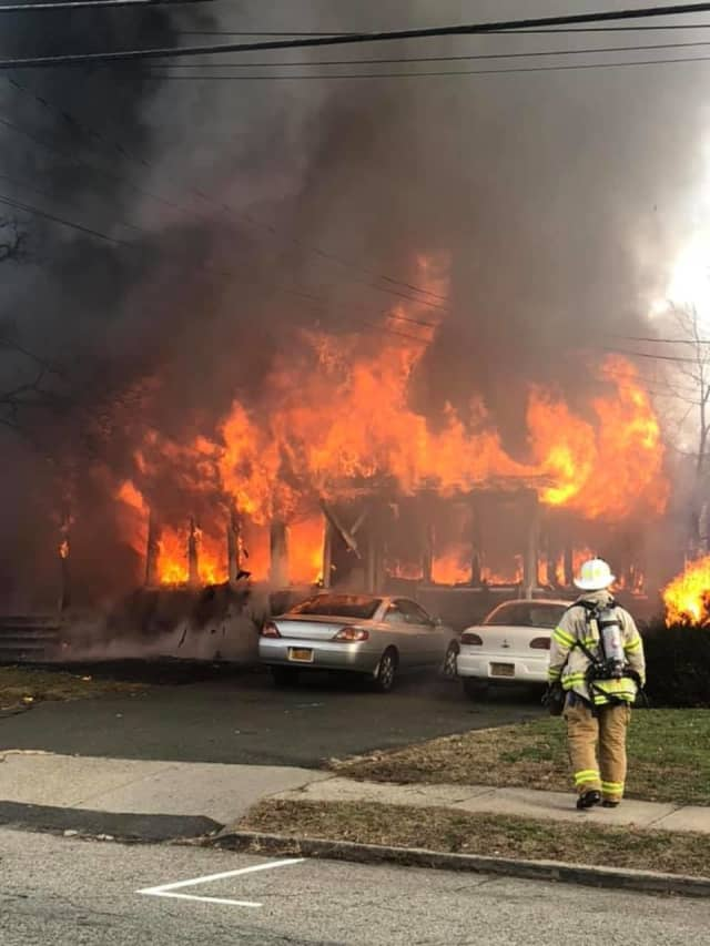 Multiple fire departments are battling a massive fire in Suffern.