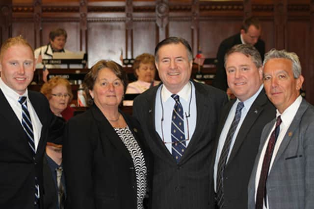State Reps. Stephen Harding and Jan Giegler welcome Western Connecticut State University President John Clark to the state Capitol.