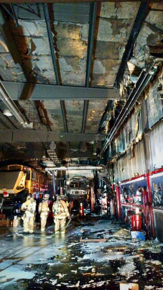 Yorktown Heights Volunteer firefighters battle a blaze at a school bus depot.