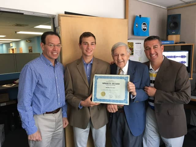 Hendrick Hudson High School senior and Con Ed Athlete of the Week Adam Kissner with his father, Paul Kissner, legendary broadcaster Bob Wolff, and tennis coach Bradley Fredman.