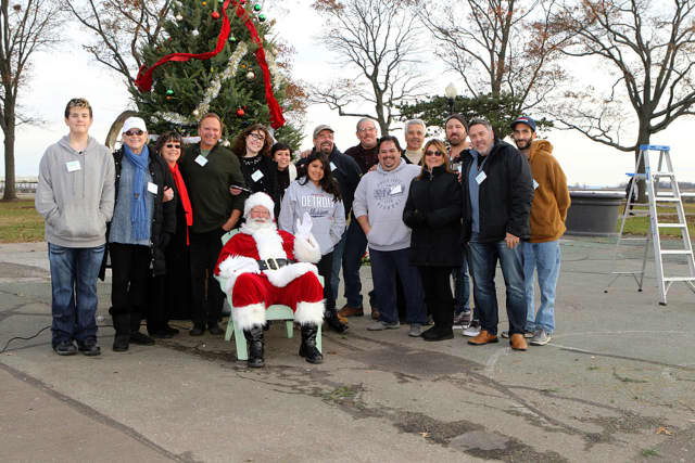 Volunteers and sponsors of Ripka's Giving Tree, which was held at Calf Pasture Beach in Norwalk