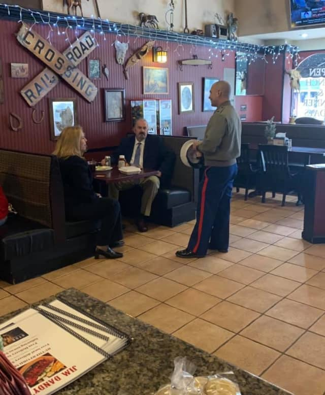 A U.S. Marine who recently relocated to the area had his lunch paid for by Rutherford councilwoman Stephanie McGowan, pictured here talking to him with her colleague from Felician University.