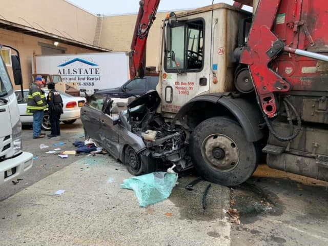 One person is critical following a crash with a garbage truck.