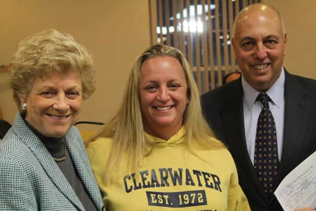 Dawn Altamuro, center, is honored with the 2014 Mayor's Volunteer Award by Franklin Lakes Council President Paulette Ramsey, at left, and Mayor Frank Bivona, at right.