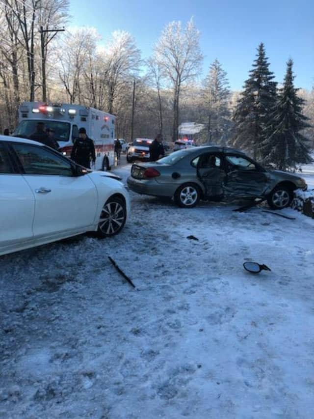 Two people were injured in a crash due to slippery roads.