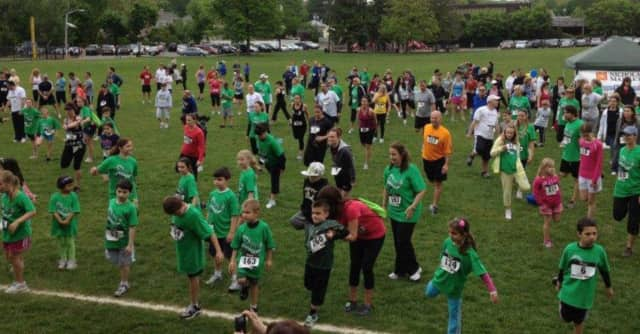 """The crowd grooves at a previous North Haledon """"Rock and Run for Education"""" event."""