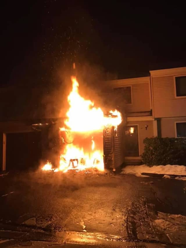 Bethel firefighters were able to contain a condo garage fire to one unit.