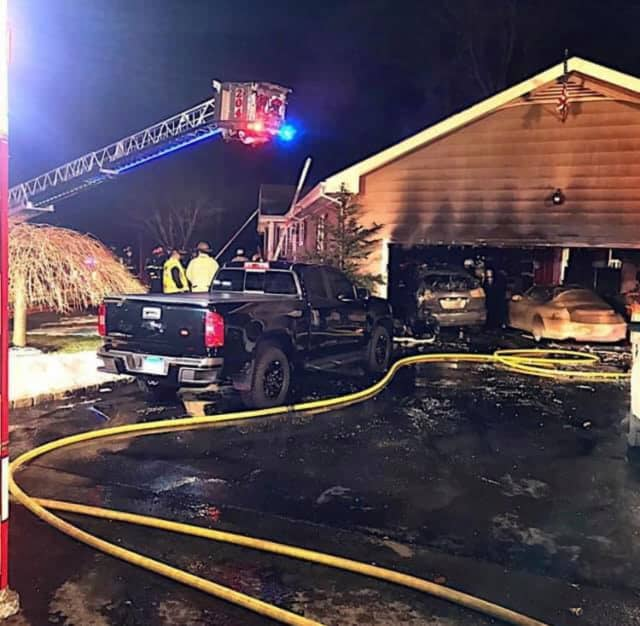 A couple of vehicles were destroyed, but the home was saved by firefighters.