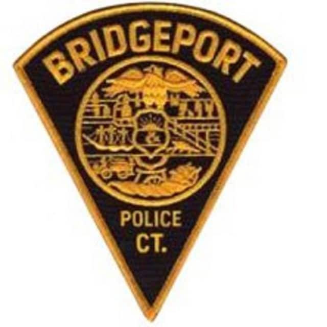 A Bridgeport man traveling in a car was killed by a brick thrown from a crowd of people Saturday.