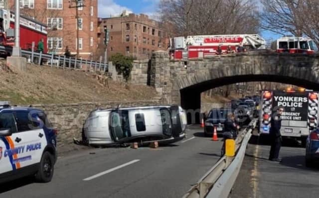 Police are looking for the driver of a sedan that flipped on the Bronx River Parkway.