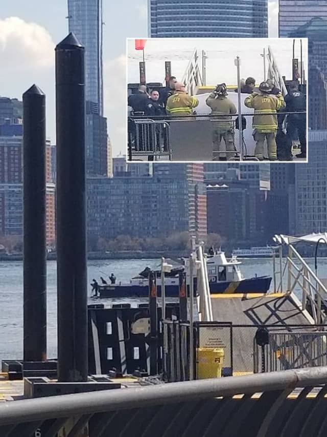 Witnesses gathered along the Hudson River in Jersey City as the body, which was bagged on the boat, was brought to shore around 12:30 p.m.