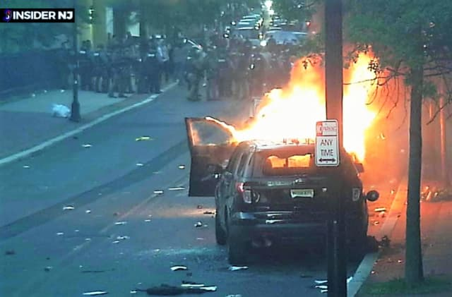 Trenton police car burns during May 31 riot.