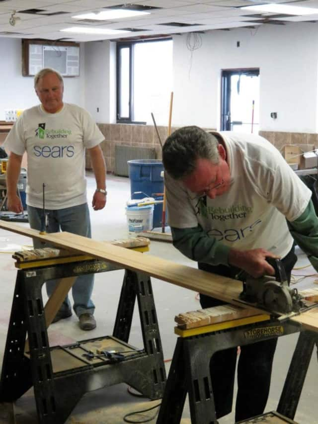 Rebuilding Together officials fix up a Little Ferry home.