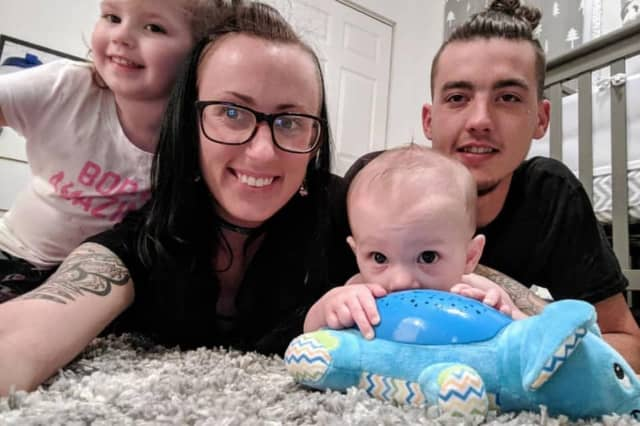 Patrick Claffertty with his his partner and two children.