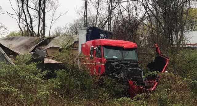 A tractor-trailer driver escaped injury during a rollover crash.