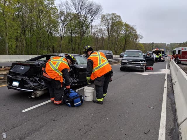 Three people were injured during a three-vehicle crash on the Merritt Parkway.