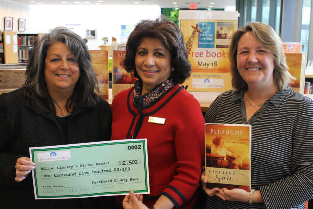 The Wilton Library's Wilton Reads event begins May 18. Pictured: Fairfield County Bank Vice President and Wilton Library trustee Carol Johnson, Wilton Library Executive Director Elaine Tai-Lauria and Karen Danvers, program manager for the library.