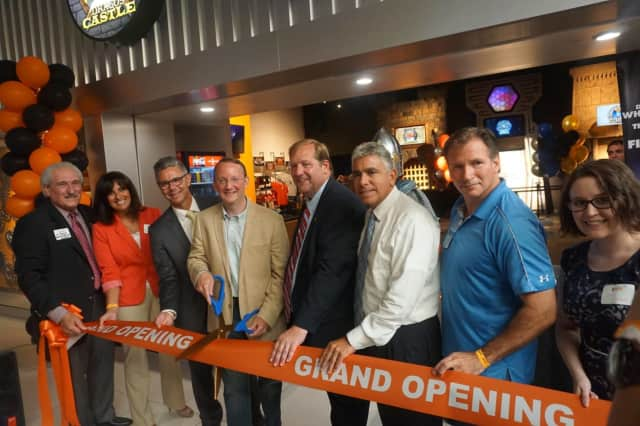 Cutting the ribbon at 5 Wits in West Nyack last month were, from left, Al Samuels, Lucy Redzeposki, Darrin Houseman, entertainment center founder Matthew DuPlessie, George Hoehmann, Frank Borelli, John Noto and Asia Seibert.