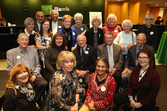 Thirty-five clinical and lay volunteers have donated their time for at least five continuous years to the Bergen Volunteer Medical Initiative. Many of them are shown here at the volunteer appreciation party hosted by TD Bank.