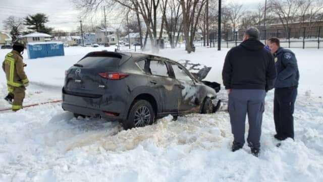 Mazda that burned in snow in Little Ferry.