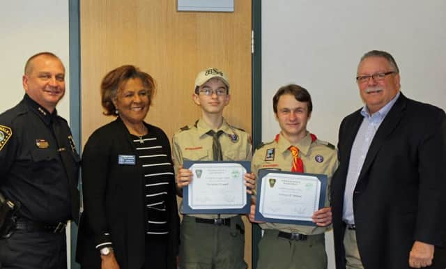 From left: Police Chief Thomas Kulhawik, Commissioner Fran Collier-Clemons, First Class Scout Nathaniel Grauel, Life Scout Anthony D'Andrea and Commissioner Charles Yost.