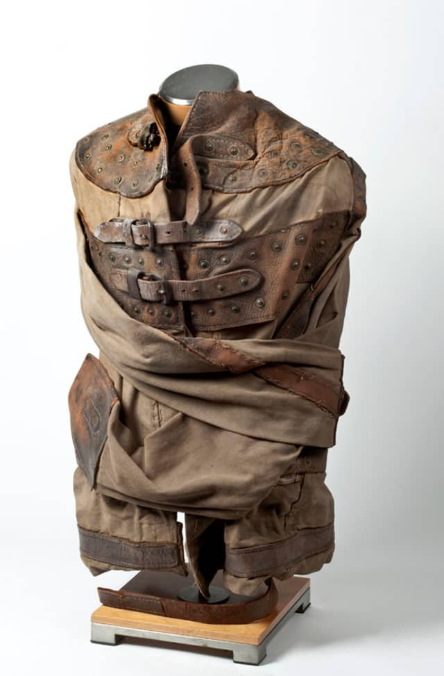 Regulation straitjacket used by Harry Houdini, ca. 1920. When police handcuffs – or any handcuffs for that matter – proved too easy to escape from, the heavy canvas, metal rings, and reinforced leather straps of straitjackets enticed Houdini. From the first outdoor performance in Kansas City (1915) to New York, Houston and Boston, Houdini performed suspended from cranes or tall buildings, preferably the ones housing major local newspapers; and following page, inset, Merv Taylor Round Birdcage Production, ca. 1960. Bird cages appearing out of thin air, and birds vanishing from cages, have long been part of magicians' acts. Copperfield Collection. Photographs by Glenn Castellano. Courtesy New-York Historical Society Museum & Library.