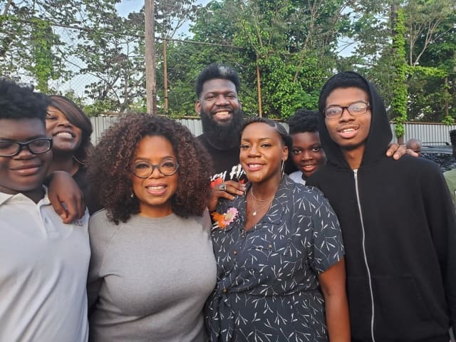 Oprah Winfrey visits West Side High School in Newark Friday. She's seen here with students and faculty, including Principal Akbar Cook (rear, center).