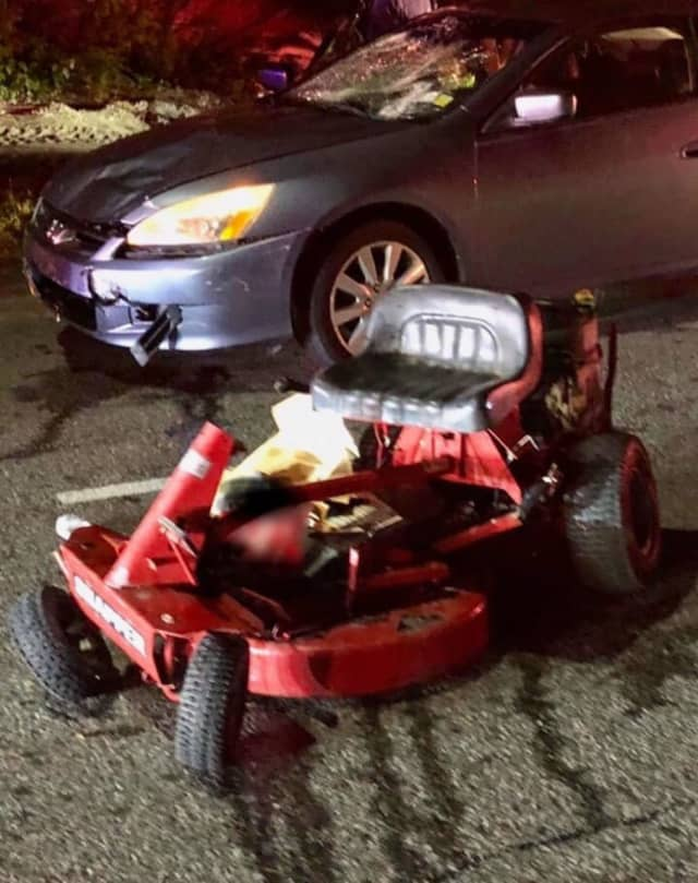 Two brothers are in critical condition after being hit by a vehicle while riding a lawnmower.