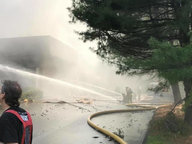 More than 100 firefighters responded to a Bethel fire at a corporate complex.