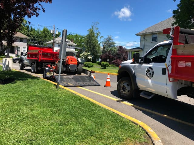 A driver left the scene after striking a DPW worker in Rochelle Park Friday near Midland School, according to police.