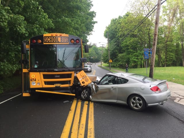 One person was injured when a car crashed into an unoccupied school bus.