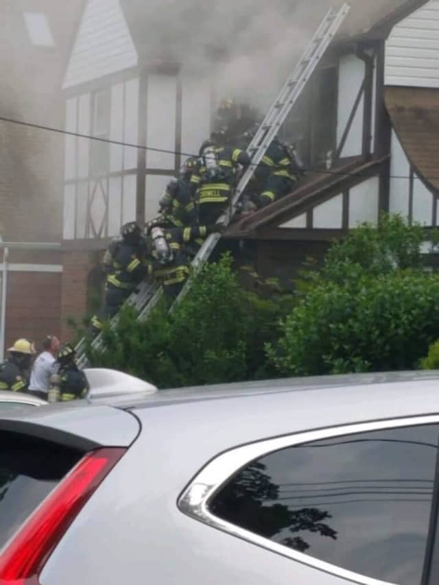 Firefighters at the scene of a deadly blaze in Millburn June 5