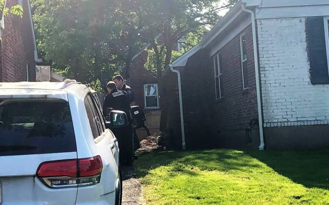 Anita Flaim was found dead in her neighbor's driveway Monday morning.