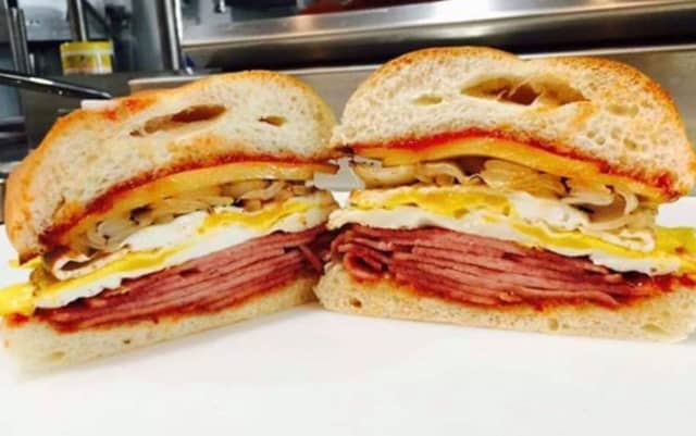 Taylor ham (most definitely NOT pork roll, the owners say), egg, cheese and onion with sriracha ketchup at Millburn Deli.  .
