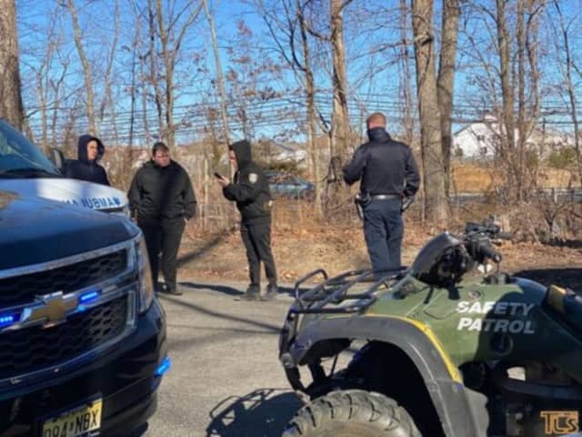 Members of the Lakewood Civilian Safety Watch found the man frozen solid inside a patch of woods Monday morning.